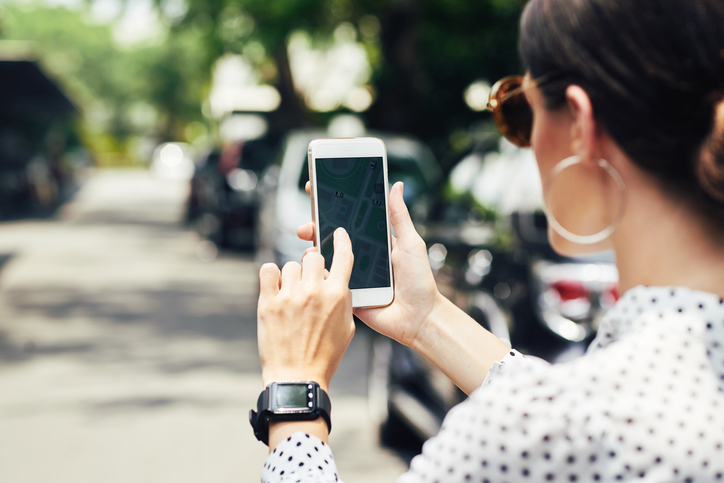 Close-up image of woman examining map in her navigation mobile application