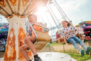 kids on theme park swings ride
