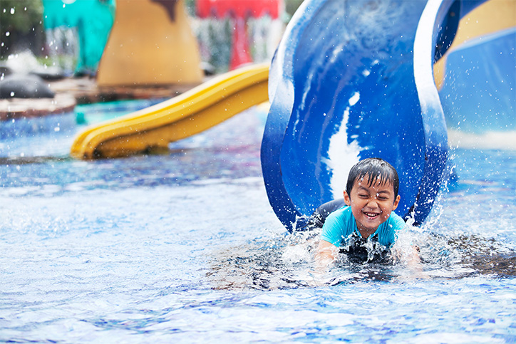 child going down waterslide